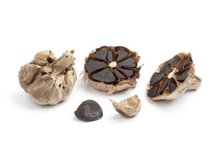 Black garlic on white background
