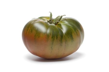 Whole single RAF heirloom tomato on white background