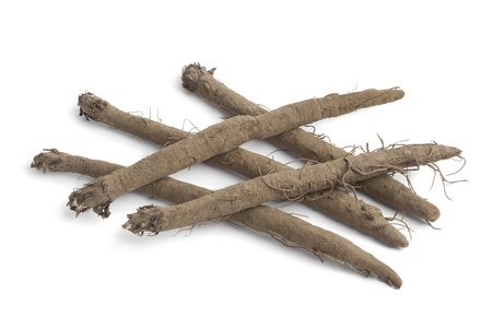 burdock: Fresh Burdock roots on white background Stock Photo
