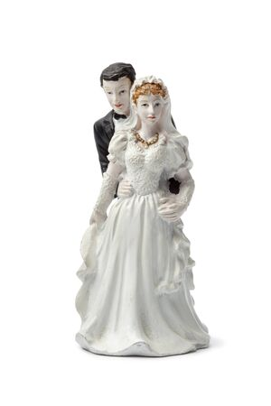 Old plaster bride and groom cake topper isolated on white background