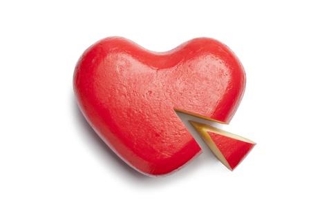 Heart shaped Gouda cheese on white background photo