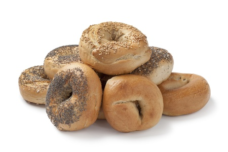 Fresh assorted bagels on white background