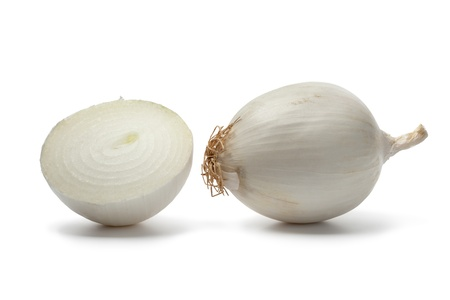 Whole and half fresh white onions Stock Photo