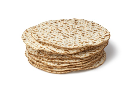 Fresh pile of matzah on white background photo