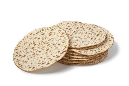 Fresh pile of matzah on white background