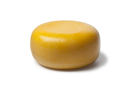 dutch:  Whole yellow Dutch Gouda cheese on white background
