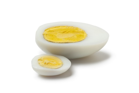 Cooked chicken and goose egg cut in half on white background photo