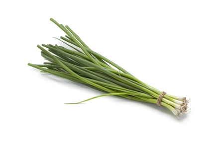 Small fresh green spring onions on white background