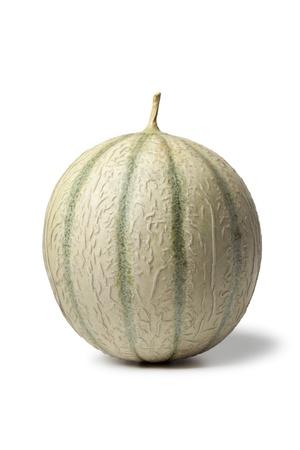 Whole fresh ripe Charentais melon on white background