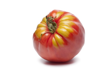 heirloom: Single Coeur de Boeuf tomato on white background