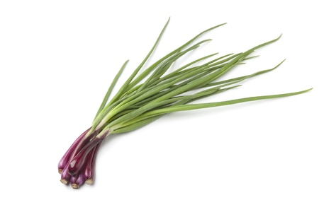 spring onions:   Fresh red scallions white background