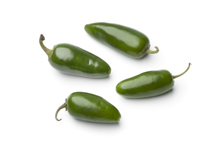 Fresh green Jalapeno chili peppers on white background photo