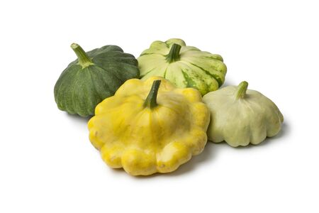 Different types of  Pattypan Squashes on white background