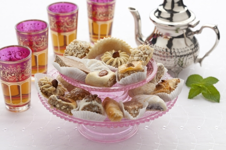 high tea:  Moroccan high tea with cookies and mint tea on white background Stock Photo