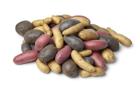 heirloom:  Variety of heirloom gourmet potatoes on white background