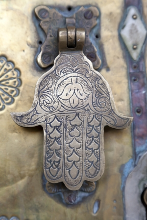 Metal doorknocker Hand of Faitimah, Marrakech, Morocco, April 1, 2012