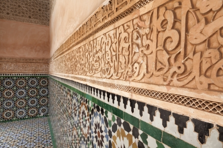 Plaster wall decoration and mosaic in the Medersa ben Youssef, Marrakech, Morocco, April 1, 2012 Redactioneel
