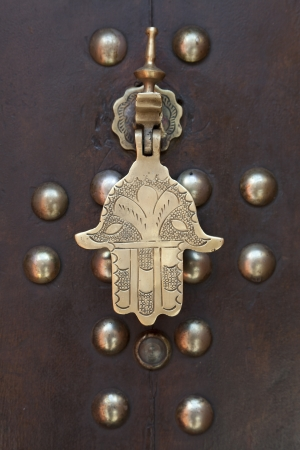 Marakech, Morocco, April 1, 2012, Metal doorknocker Hand of Faitimah  photo