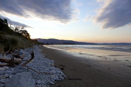 marlborough:  Sunset on the beach of the Marlborough Sounds New Zealand Stock Photo