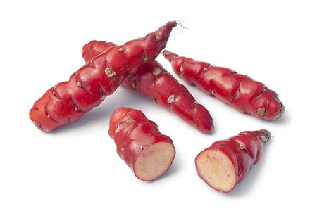 heirloom: Fresh red New Zealand yams on white background
