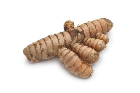 curcumin: Fresh curcuma root on white background