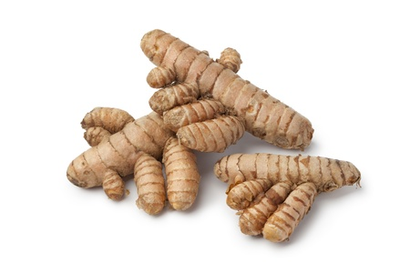 curcumin: Fresh curcuma roots on white background Stock Photo