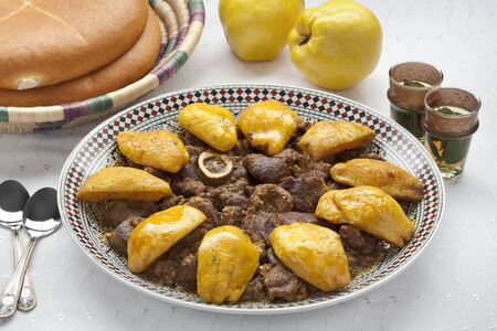 moroccan cuisine: Moroccan dish with meat and Safarjal on white background Stock Photo