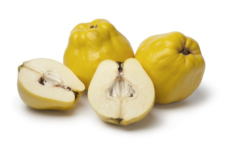 Fresh yellow whole and half Quinces on white background