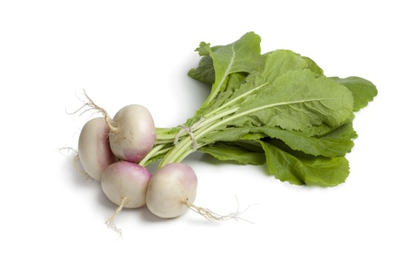 Fresh young small turnips on white background
