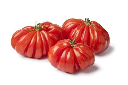 rebellion: Organic Rebellion tomatoes on white background