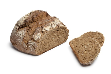 multi grain: Multi grain farmers bread with slices on white background