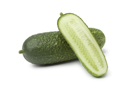 homegrown: Homegrown organic cucumbers on white background