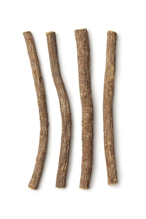 Liquorice roots on white background Stock Photo