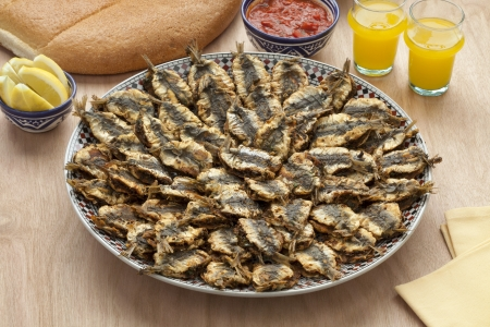 Dish with Moroccan fried stuffed sardines,sauce and bread photo