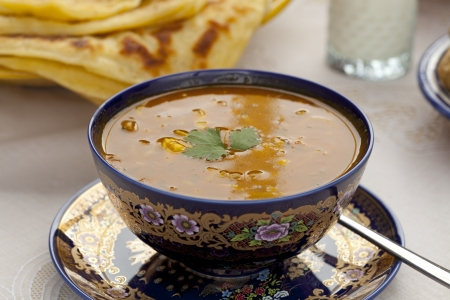 Cup of  Moroccan harira soup served in traditional bowl with Msemen Stock Photo