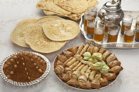 Traditional Moroccan tea,cookies, almond sellou and pancakes at id-al-fitr the end of Ramadan