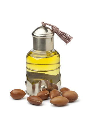Bottle of Moroccan cosmetic Argan oil and nuts
