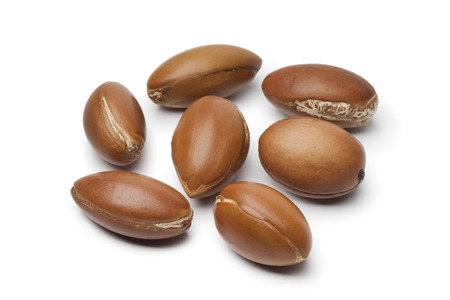 Whole Moroccan Argan nuts on white background
