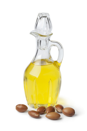 Moroccan cosmetic Argan oil and nuts on white background Фото со стока - 23215289