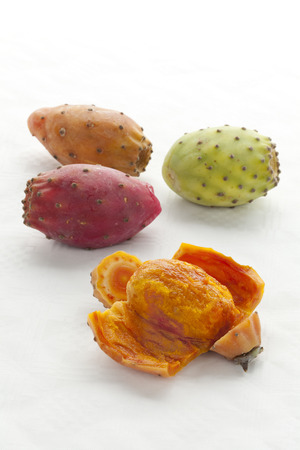 Whole and peeled Prickly Pear Fruit close up