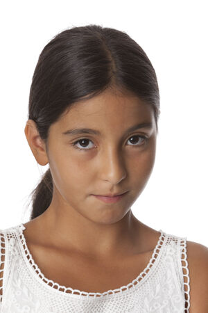 11 years: Young timid teenage girl, portrait on white background