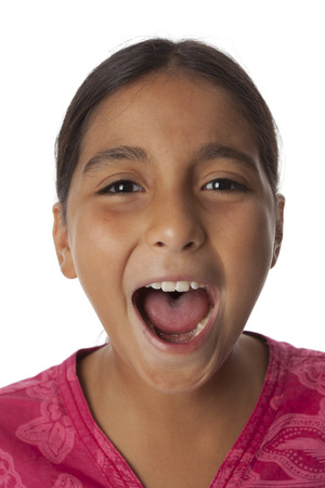 Young teenage girl screaming loud on white background   photo