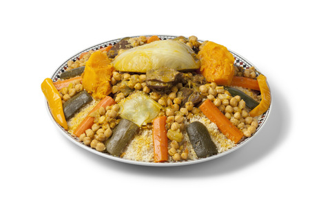 Moroccan couscous dish on white background