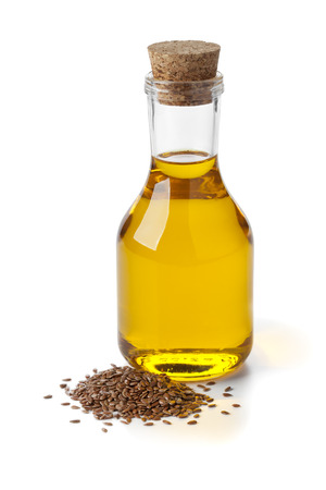 linseed oil: Bottle of flax seed oil ans seeds on white background Stock Photo