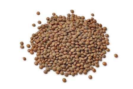 Heap of mountain lentils on white background