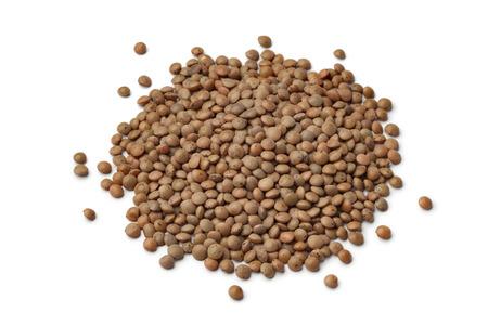Heap of mountain lentils on white background