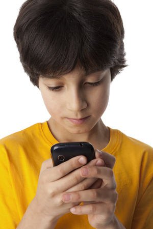 eight year old:   Eight year old boy reading text message on white background Stock Photo