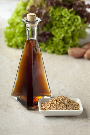 roasted sesame:  Sesame oil and roasted sesame seeds to use for a dressing Stock Photo