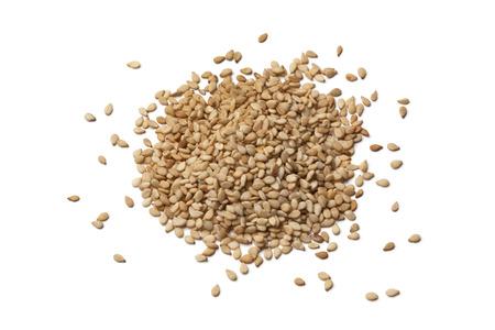 Roasted sesame seeds on white background Banque d'images
