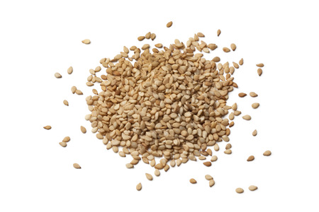 Roasted sesame seeds on white background Banco de Imagens